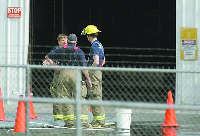 Hazardous materials crews cleaned up a small hydrochloric acid spill Friday at a Mound House business.        Cathleen Allison/Nevada Appeal