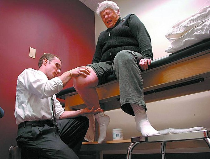 Andre F. Chung/The Baltimore Sun Marlene Freed, 68, is assisted by physical therapist Chris Gnip as she undergoes physical therapy.