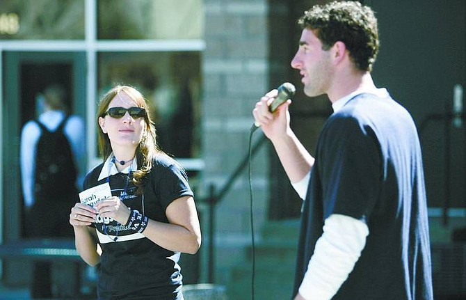 Cathleen Allison/Nevada Appeal Wolf Pack quarterback Jeff Rowe speaks at a rally last week in support of his cousin Sarah Ragsdale, left, who is running for president of the Associated Students of the University of Nevada, Reno. Ragsdale, a 2004 Carson High School graduate, is hoping to become only the sixth female president in the school's history.