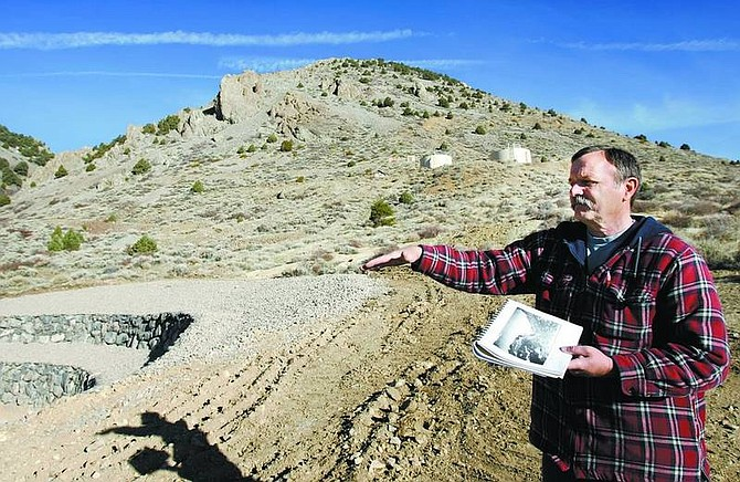 Chad Lundquist/Nevada Appeal Archeologist Pete Matranga compares the similarities of historic photos and the area's landmarks which helped identify remnants of what is believed to be the old Bullion mine. The site that the artifacts were found on is destined to hold Storey County's new water tower.