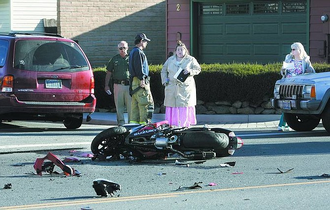Cathleen Allison/Nevada Appeal A Carson City man was taken to the hospital Friday morning following an accident in which a mini van crossed into his path at East College Parkway and Granite Street.