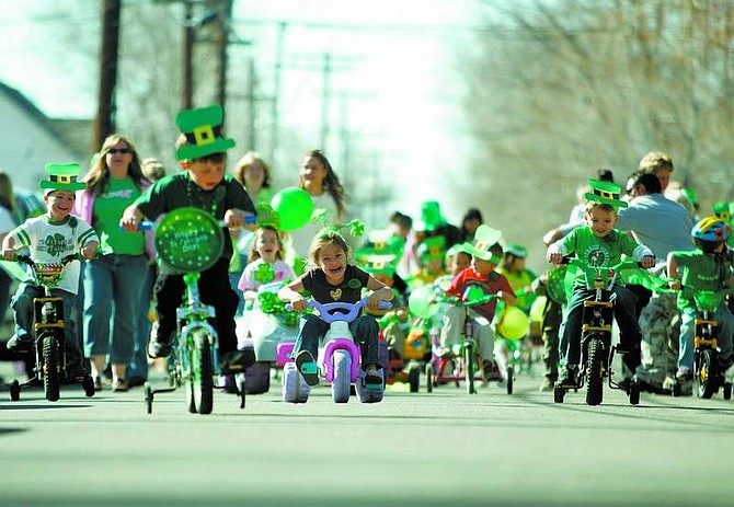 BRAD HORN/Nevada Appeal Kinderland day care students race on Curry Street during their annual St. Patrick's Day Parade on Friday.