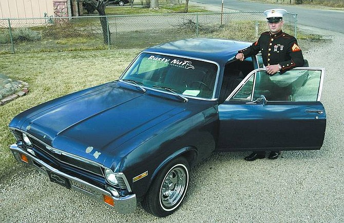 Cathleen Allison/Nevada Appeal U.S. Marine Corp. Steve Lubich stands with his 1972 Chevy Nova while home on leave Wednesday. The car, originally purchased by his dad, John, in 1972, was badly damaged in the New Year's flood of 2006. A number of local friends and businesses helped get it back in shape for Lubich.
