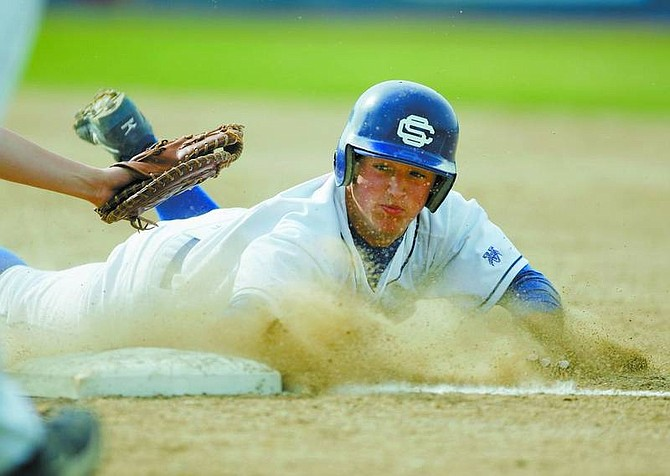 BRAD HORN/Nevada Appeal Carson's David Leid dives into first base during the Senator's game against South Lake Tahoe at Ron McNutt Field on Thursday.
