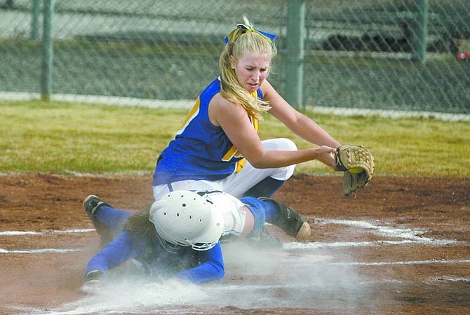 Cathleen Allison/Nevada AppealCarson's Katie McEwan gets tagged out by South Tahoe's Kelly Bartlett during Thursday's game at CHS. Carson won 10-0.