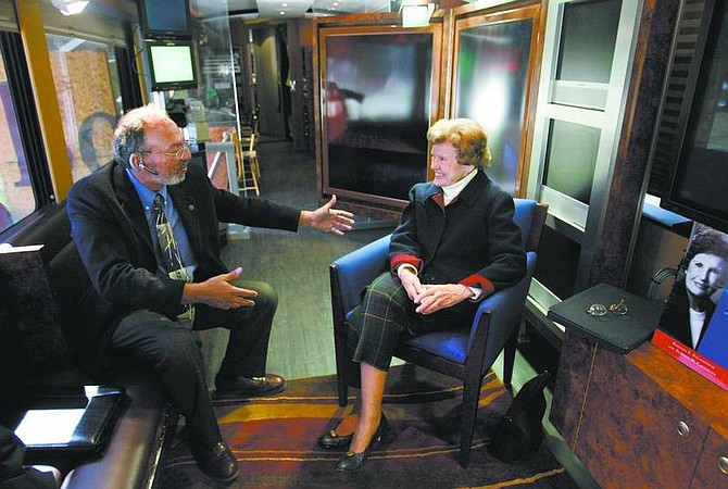 Cathleen Allison/Nevada Appeal George Jostlin, with Charter Communications, talks with former Congresswoman Barbara Vucanovich Friday on the Book TV bus in the Legislative Plaza. Vucanovich is one of 2,500 authors to be featured on the program this year.