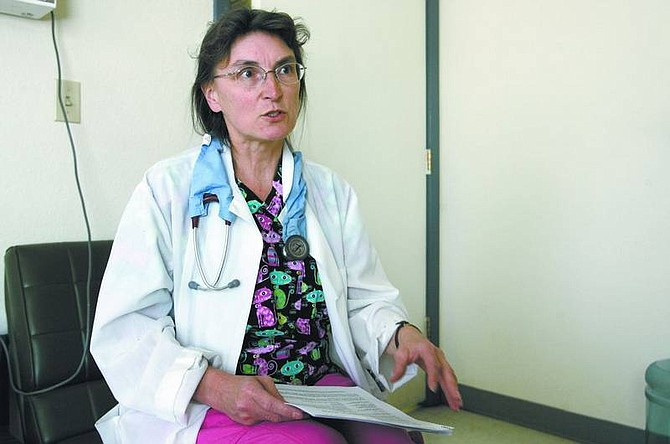 Cathleen Allison/Nevada Appeal Dr. Pamela Jahn, of Carson-Tahoe Veterinary Hospital, talks Thursday about a local cat that died this week of renal failure. The cat's death is suspected to be connected with massive contamination of pet food.