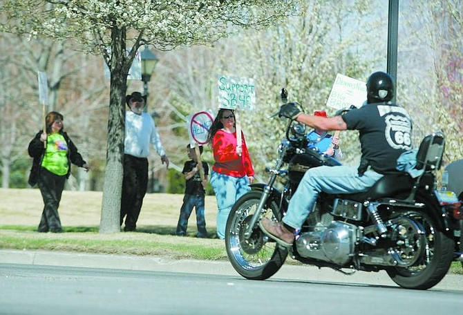 BRAD HORN/Nevada Appeal Protesters walk along Carson Street in front of the Nevada State Legislature on Saturday. The motorcycle group advocates more lenient helmet laws.