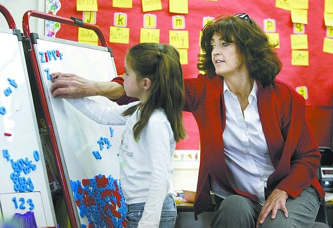 Cathleen Allison/Nevada Appeal  Hugh Gallagher Elementary School kindergartner Cierra Frisby, 5, spells in Connie Carlson's class on March 13. Carlson is retiring after 29 years of teaching in Virginia City.