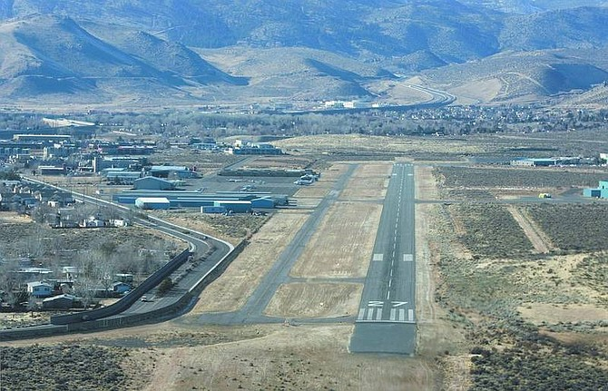 Cathleen Allison/Nevada Appeal Looking west on approach at the landing strip at the Carson City Airport, as seen from the air. The airport's master plan calls for realigning the runway more to the north, so aircraft fly over the Empire Ranch Golf Course instead of homes.