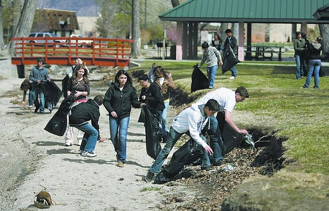 Cathleen Allison/Nevada Appeal About two dozen Carson High School leadership students picked up trash at Mills Park on Tuesday afternoon as a community service project.