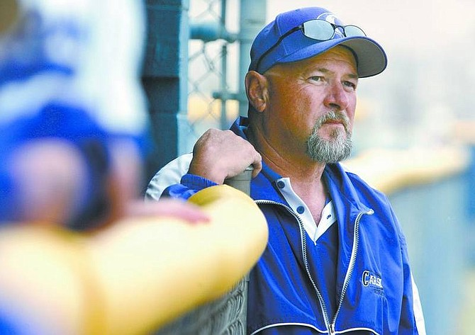 Cathleen Allison/Nevada Appeal Carson High School assistant softball coach Bob Carvin watches Tuesday's game at CHS.