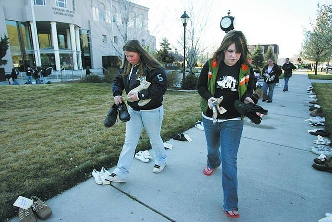 """Photos by Cathleen  Allison/Nevada Appeal Katie Mandoki, 15, left, and Kim Burke, 17, joined about 100 students from around Northern Nevada for """"Kick Butts Day"""" at the Legislature on Wednesday to promote awareness and support for tobacco-prevention programs."""