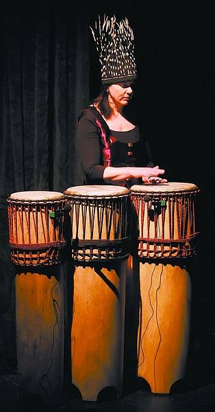 """Chad Lundquist/Nevada Appeal Liz Broscoe, of South Lake Tahoe, rehearses her part in """"Durga: Goddess of the Drum"""" at the Brewery Arts Center Performance Hall on Tuesday. The narrated multimedia performance features a mix of film, music and dance. The show opens Friday at 7:30 p.m. and plays again at that time on Saturday and 2 p.m. Sunday at the BAC Performance Hall."""