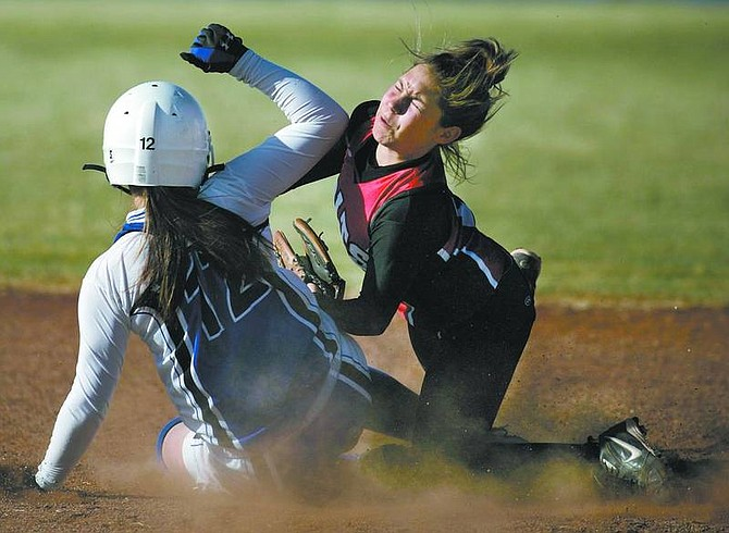 Cathleen Allison/Nevada AppealCarson's Daria Leid collides with Wooster shortstop Melanie Pfieffer on a steal attempt in Thursday's game at CHS. Leid was out on the play, but Carson won 11-2.