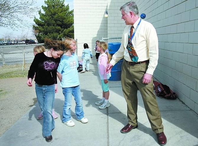 Chad Lundquist/Nevada Appeal Dayton Elementary School Principal Nolan Greenburg talks with third-grade students Stella Taylor, 8, and Lauren Bailey, 8, Monday after school. Greenburg will take over Dayton Elementary School III next year.