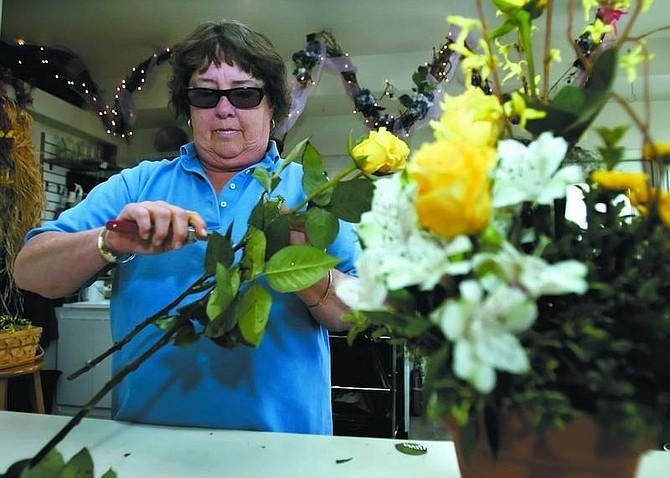 Chad Lundquist/Nevada Appeal Gretchen Beitel works on a bouquet Wednesday at Dayton Valley Floral & Nursery.