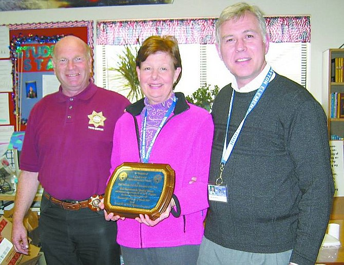 Dayton Elementary teacher Linda Peterson was awarded the 2006-2007 DARE Teacher of the Year award by Lyon County's DARE officer, Bob Kahn, left, and Dayton Elementary principal Nolan Greenberg.   Photo submitted