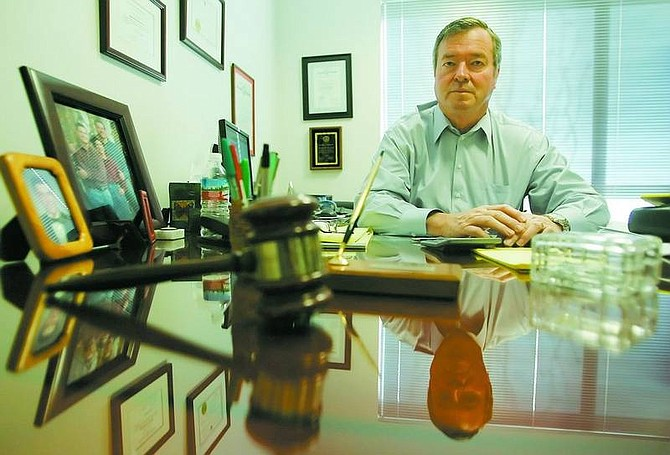 BRAD HORN/Nevada Appeal Former District Court judge Mike Griffin, who has a collection of 10 guitars, plays in a band that performs three times a year. He has hung up his robe to join a Reno law firm.