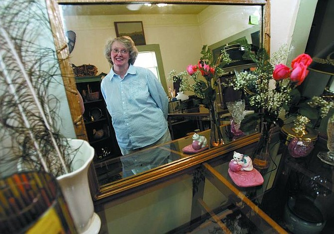 Chad Lundquist/Nevada Appeal Susan Ballew, owner of White Cat Antiques at 512 N. Curry Street, plans to have the shop open by Wednesday. It will be open  10 a.m. to 5 p.m. Wednesday through Saturday.