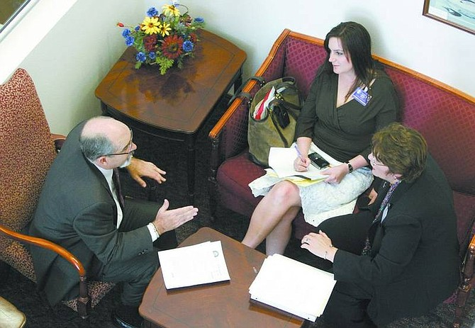 Cathleen Allison/Nevada Appeal Lobbyists, from left, Bill Bradley, Victoria Coolbaugh and Victoria Riley talk Friday at the Legislature. Bradley testified earlier Friday in support of a bill that sets a stricter standard to be able to seal court records.