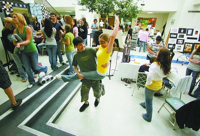 BRAD HORN/Nevada Appeal Ben Guberman, 16, dances with Carinne Powell, 17, during the occupational fair at Carson High School on Thursday. The students are in theater and concert choir.