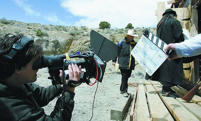 """Jeff Piccinini, director of photography, prepares to film a scene on set of the movie """"Coyote Hole"""" in Silver City on Wednesday."""