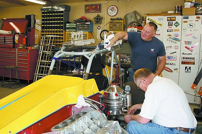 Rhonda Costa-Landers/Nevada Appeal Supermodified racecar No. 96 owner Courtney Lewis, seated, and crew chief Mike Burts, work on the racecar recently in preparation for the ASA/WSS 2007 season, which begins Apriil 28 at Madera Speedway in Madera, Calif. The car is just one of five out of Northern Nevada racing in the series.
