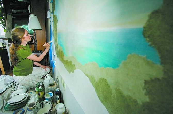 BRAD HORN/Nevada Appeal Lori Nourse paints a mural for a Reno client at her Carson City home on Wednesday.