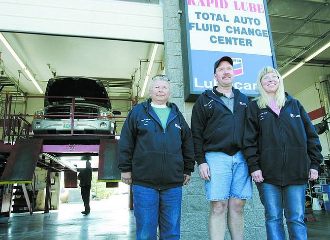 Chad Lundquist/Nevada Appeal Classic Lube & Oil owners, from left, Janet Hutchinson, Brian Sandness and Elizabeth Sandness at their 1861 E. College Parkway shop.