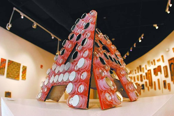"""Trevor Clark/Nevada Appeal A piece by Lisa Sheppard called """"A Work of Art"""" at the Western Nevada Community College's Recycled Art(icles) exhibit."""
