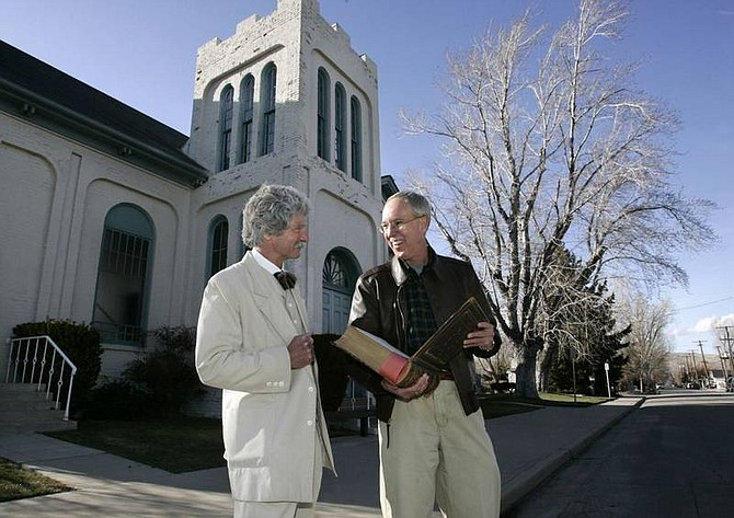 Cathleen Allison/Nevada Appeal Mark Twain impersonator MacAvoy Lane, left, and the Rev. Bruce Kochsmeier talk about the history of the First Presbyterian Church in Carson City on March 21, 2006. As a fledgling writer in his 20s, Mark Twain was well known for his carousing at saloons. But now Twain is getting attention for a little-known good deed during that period: His role in helping raise money for construction of the First Presbyterian Church in January 1864. Kochsmeier is holding a Bible dedicated to Mark Twain's niece Jennie Clemens, who died at the age of 10 in 1864.