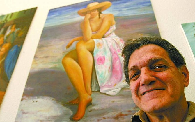 Trevor Clark/Nevada Appeal Harry Ferrigno, 65, of Carson City, poses for a portrait with some of his paintings at the Southgate Senior Apartments on California Street on Thursday.
