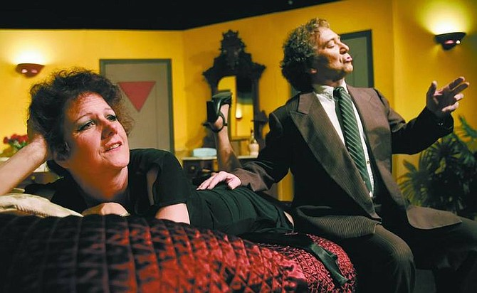 """Chad Lundquist/Nevada Appeal photos by  Karen Chandler and Jim DeZerga rehearse their roles in """"Lend Me A Tenor"""" at the Brewery Art Center on Monday."""
