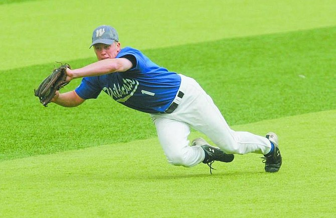 BRAD HORN/Nevada Appeal Cliff Shepard makes a diving catch in left field during the second game of the Western Nevada Community College Wildcat's doubleheader at John L. Harvey Field on Saturday.