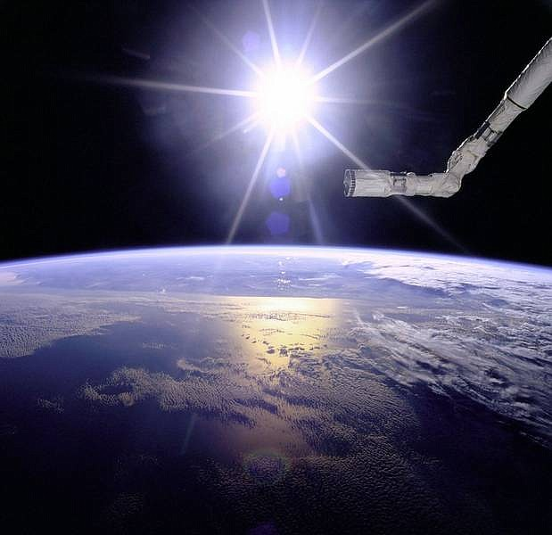 Courtesy of Earth Sciences and Image Analysis Laboratory/NASA Johnson Space Center This photo released by NASA shows a sunburst view of the Space Shuttle's robot arm over a cloudy Earth taken June 1,1996, during the flight of Space Shuttle Endeavour.