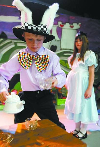 """Chad Lundquist/Nevada Appeal Fritz Filson, portraying the March Hare, and Mariah Terjo as Alice rehearse a scene from """"Alice in Wonderland"""" Wednesday at the Children's Museum of Northern Nevada."""