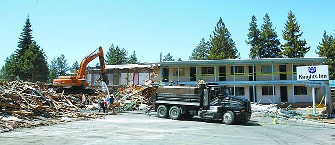 Jim Grant/Nevada Appeal News Service The Knights Inn in South Lake Tahoe is torn down on Monday as demolition of properties in the 12-acre convention center site continues just across the state line.