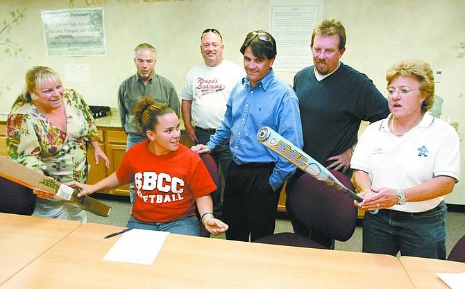 Cathleen Allison/Nevada Appeal Dacey Hassey signed her letter of intent to play softball for Santa Barbara College Friday at Carson High School. With her, from left, her mom Juanita Smith, Coaches Rob Wirth, Jim Miller, dad Bob Hassey, Coach Scott Vickrey and Athletic Director Diane Roberts.
