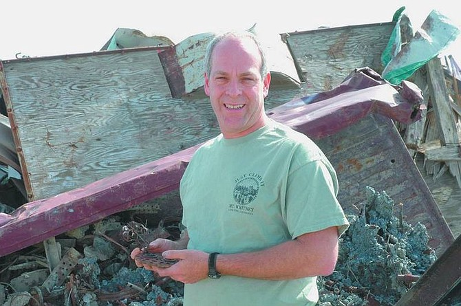 Nevada Appeal News Service Ron Fritcher picks out pieces of junk from the Western Salvage Yard between Fallon and Silver Springs with an eye to creating recycled art.