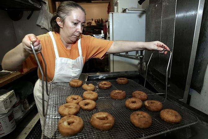 Elvira Diaz, owner of Sierra  Bakery, fries  doughnuts at her  shop in  preparation for Mexico's day to honor workers today. Diaz said Cinco de Mayo is not  celebrated as a party in Mexico, but more as a civic  celebration.  Chad Lundquist/ Nevada Appeal
