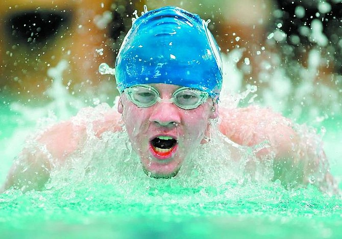 BRAD HORN/Nevada Appeal Carson's Kevin Dyer, 17, competes in the butterfly leg of the 200 meter team relay at the Carson Aquatic Center during the Zone Finals on Saturday.
