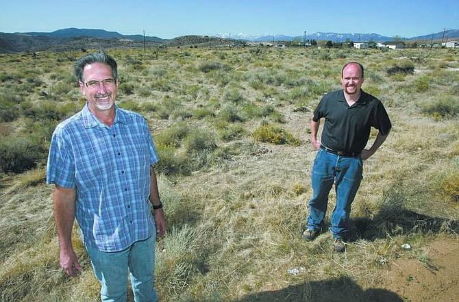 Cathleen Allison/Nevada Appeal Bill Miles, of Miles Construction, left, and CPA Phil Cowee stand in an area in Mound House where their proposed development will be.
