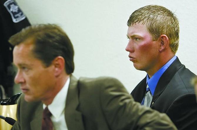 Chad Lundquist/Nevada Appeal Attorney Kenneth Stover listens to testimony in Storey County Justice Court on Monday while his client, Randy Boyd, watches. Boyd was bound over to district court for his part in an accident that killed a 16-year-old in December.