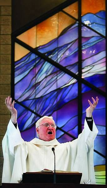 Chad Lundquist/Nevada Appeal The Rev. Jerry Hanley, 71, speaks with enthusiasm during his last sermon on Sunday at St. Teresa of Avila Catholic Church. Hanley is retiring from St. Teresa of Avila after 30 years of service.