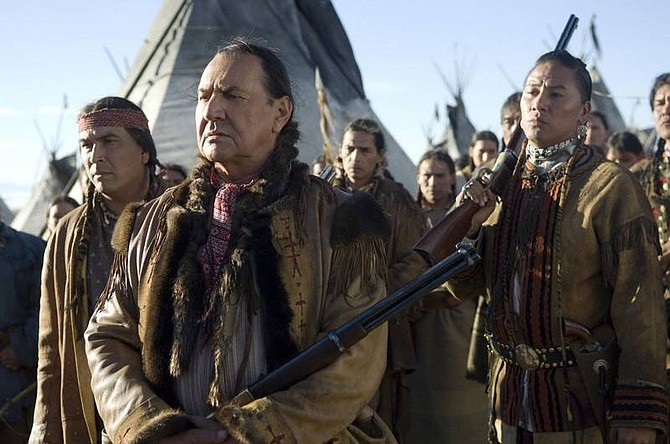 """This undated photo, supplied by HBO, shows actors Eric Schweig,left, August Schellenberg and Nathan Chasing Horse, right, in the HBO made-for-TV movie """"Bury My Heart at Wounded Knee."""" The movie garnered 17 Emmy nominations, which were announced in Los Angeles Thursday, July 19, 2007. (AP Photo/HBO, Annabel Reyes)"""