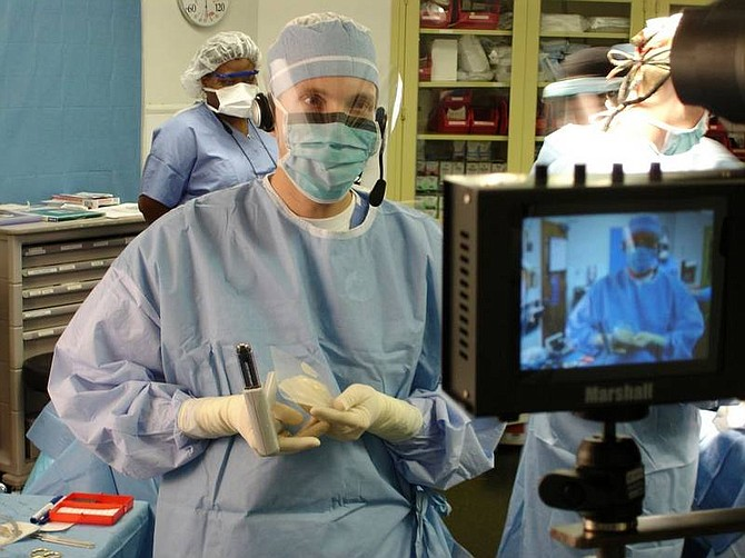 Georgetown University Hospital Dr. John Steinberg, a podiatrist at Georgetown University Hospital, holds a piece of synthetic skin at the hospital in Washington Sept. 28 before grafting it onto a diabetic's foot wound in an operation broadcast live to a meeting of doctors working to prevent diabetic limb amputations.