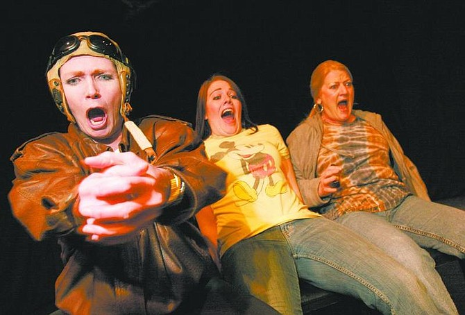 Trevor Clark/Nevada Appeal 'Wonder of the World' cast members Coleen Katen, Susan Lingelbach and Lisa Bommarito react while rehearsing a scene involving a helicopter ride at the Brewery Arts Center on Monday night.