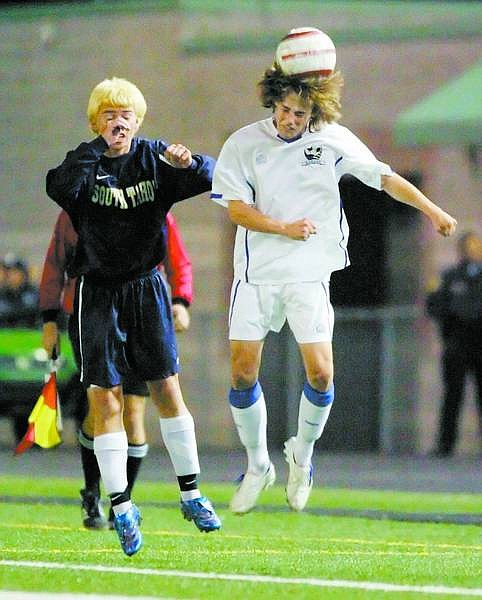 BRAD HORN/Nevada Appeal Carson's Nikolaus Marsh heads the ball during their semi-final playoff game in the NIAA soccer tournament on Thursday.