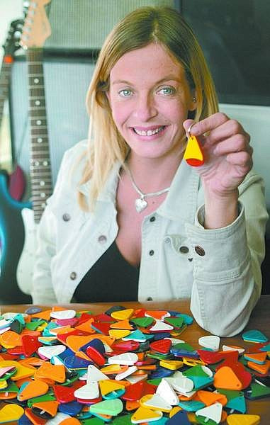 Cathleen Allison/Nevada Appeal Julia Shadden is the owner of KeyPik.com, an Internet-based company that sells key fobs that hold guitar picks.